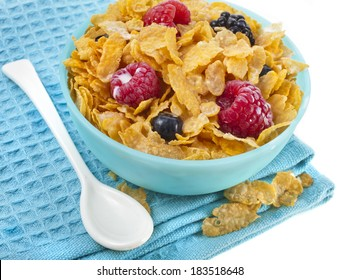 corn flakes with fresh berries and milk isolated on white background