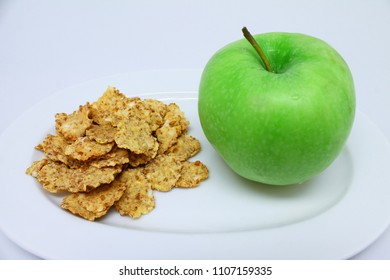 Corn Flakes and Green Apple Healthy Breakfast on isolated white background