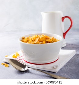Corn flakes with milk on light gray background. Copy space. Healthy breakfast concept.