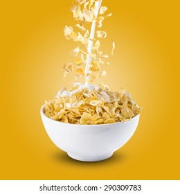 Corn Flakes and Milk Splash on Bowl of Cereal