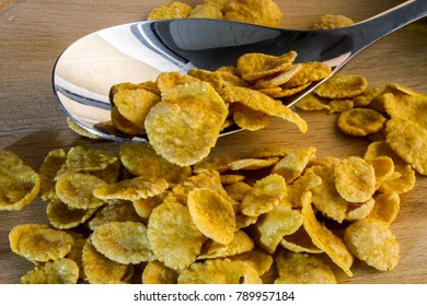corn flakes and a spoon on the table