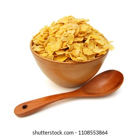 Corn flakes in wooden bowl on white background