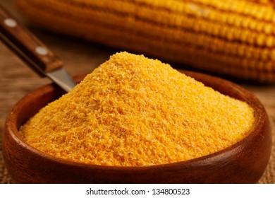 Corn flour in homemade wooden bowl