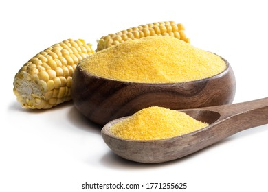 Corn  grits polenta in wooden bowl isolated on white