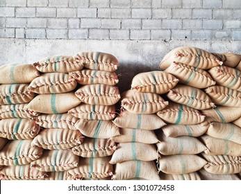 Corn in gunny sack for make animal feed in warehouse.