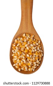 Corn kernels in a wooden spoon isolated on white background