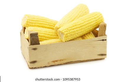corn on the cob in a wooden crate on a white background