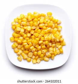 Corn on a white plate isolated on white. Top view.