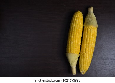 Corn on wood background.