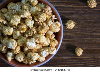 Corn popcorn in a bag on a wooden background