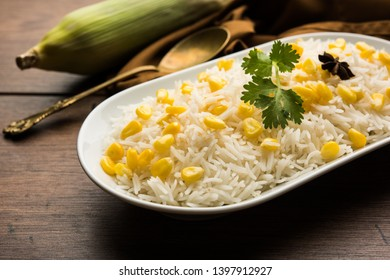 Corn Rice made using boiled Maize seeds with basmati rice, served in a bowl. selective focus
