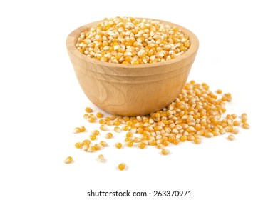 Corn seed on wooden dish isolated