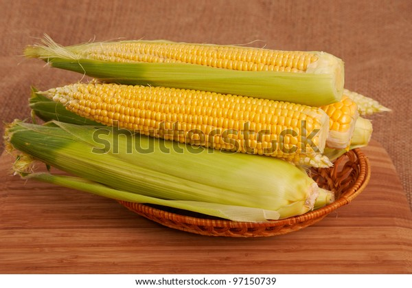 Corn in small dish on the table.
