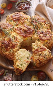Corn, sun-dried tomatoes and thyme scones. Selective focus