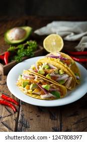 Corn tacos with chicken, avocado and mango