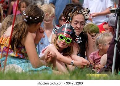 Cornbury Festival - July 11 2015: Children enjoying entertainment at Cornbury Festival,  Great Tew Park, Chipping Norton, Oxfordshire, July 11, 2015 in Oxfordshire, UK