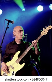 Cornbury Festival - July 8th 2016: Bassist Norman Watt-Roy performing with  Wilko Johnson at Cornbury Festival, Great Tew Park, Chipping Norton, Oxfordshire, July 8, 2016 in Oxfordshire, UK