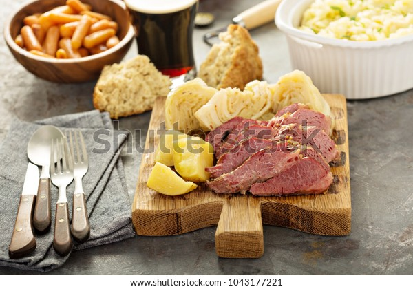 Corned beef and cabbage on a cutting board, Irish traditional dinner