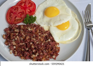 Corned Beef Hash, Fried Eggs and Tomatoes