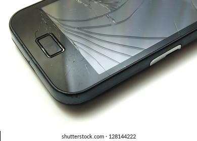 corner of broken smartphone screen, shot on white