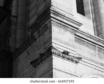 Corner of the cathedral bell tower of Ferrara, Italy.