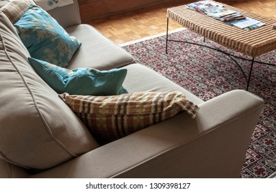 Corner of a comfy couch with pillows