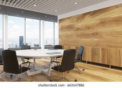 Corner of a dark wooden wall decoration and a large round meeting room table. 3d rendering mock up