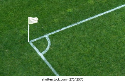 A corner flag on a soccer stadium green grass