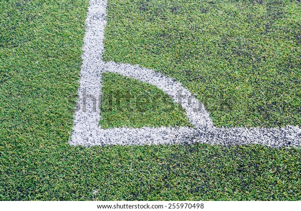 The corner of football field. Artificial Grass soccer background.