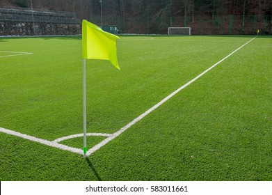 corner in the football field with artificial turf flag