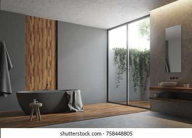 Corner of a gray and wooden bathroom with a concrete and wooden floor, a gray bathtub and a towel. 3d rendering mock up