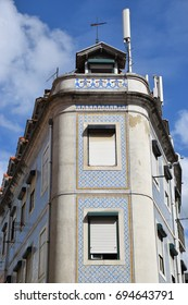 Corner house in Lisbon decorated with blue tiles