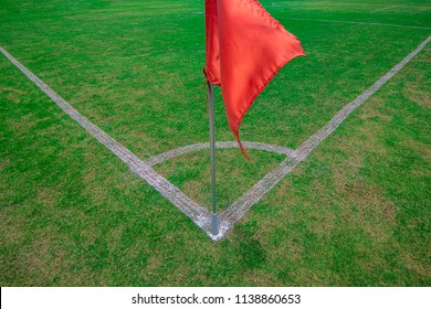 Corner Kick,Red flag at one corner of football stadium and soccer corner of a soccer field