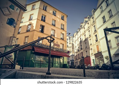 """Corner of little streets in Montmartre, Paris, seen from the top of a typical staircase. This was the set of the movie """"Amelie Poulain""""."""