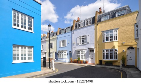 Corner of old London street of small terraced houses, without parked cars.