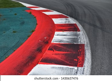 Corner in the race track with curbs.