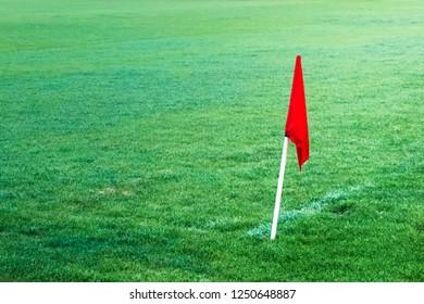 Corner red flag in football soccer field