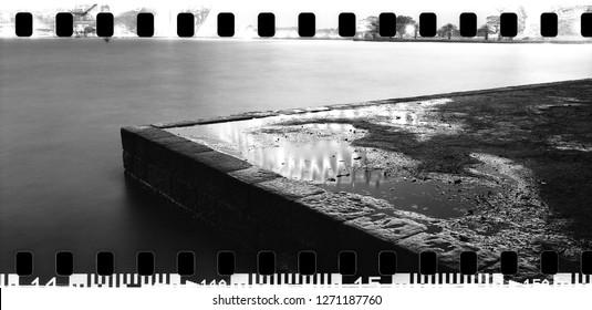 corner stone pier jetty wharf reflection bright city lights water surface night long-exposure wide panorama 35mm film sprockets Sydney Harbour Australia NSW monochrome film analog analogue vintage