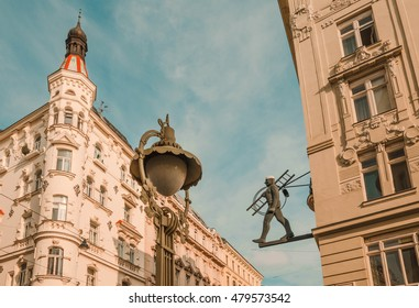 Corner street at the heart of Vienna. There can be seen an artistic sign of a chimney sweep. In the past, to bump into one, was a good luck symbol.