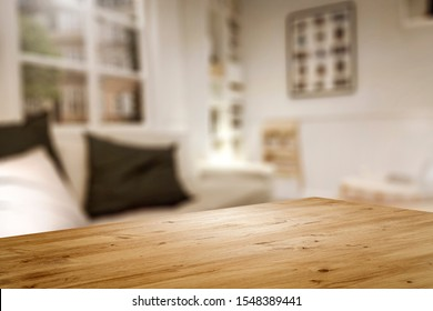 Corner of table with empty space for your product. Blurred home interior and christmas time. Copy space.