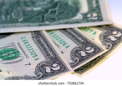 corner of two dollar bills and seals US crisp isolated