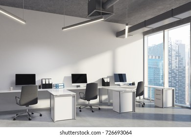 Corner of an upscale open space office interior with white walls, a concrete floor and ceiling and rows of white desks with computers standing on them. 3d rendering mock up
