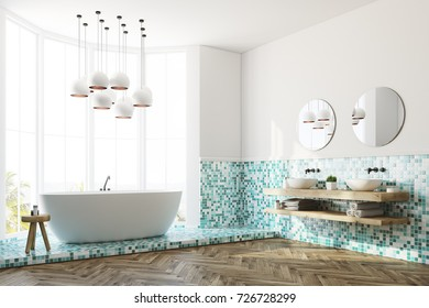 Corner of a white and green tiles bathroom interior with a large window, a white round tub, a double sink and a white lamp. 3d rendering