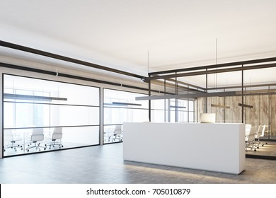 Corner of a wooden office interior with a white reception, two laptops standing on it, a glass wall and a concrete floor. 3d rendering mock up