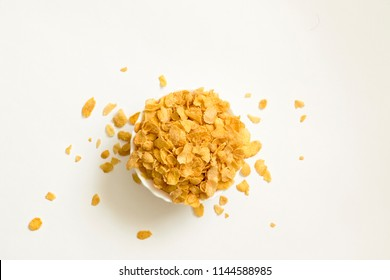 Cornflakes in bowl isolated on white background Top View