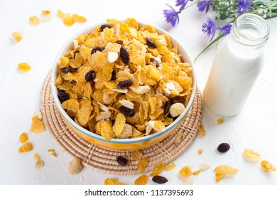 Cornflakes cereal and milk . Morning breakfast