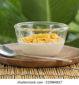 cornflakes cereal with milk on the cup