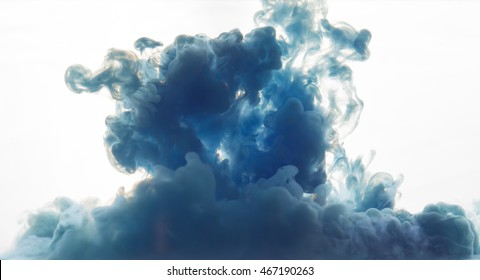 cornflower blue cloud of smoke made with dye in water on white background