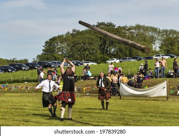 CORNHILL, ABERDEESNHIRE, SCOTLAND - 7 JUNE: This is Tossing the Caber at the Cornhill Highland Games, Aberdeenshire, Scotland on 7 June 2014.