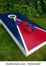 Cornhole Board Toss Game on Grass in Summer